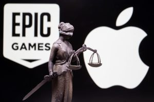 Apple and Epic logos with statue representing Lady Justice